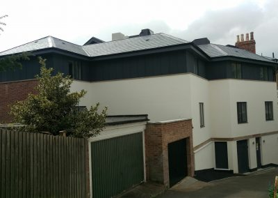 Basement + three storeys next to garage - party wall matters